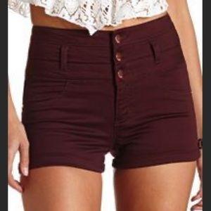 High waisted maroon shorts